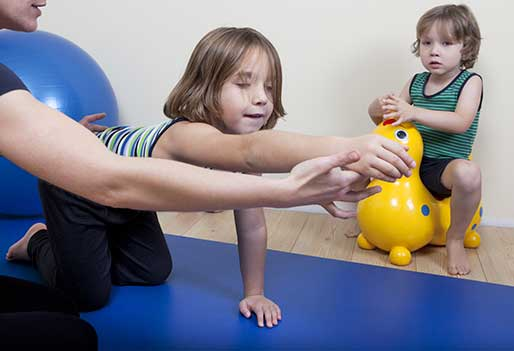 child in occuaptional therapy session